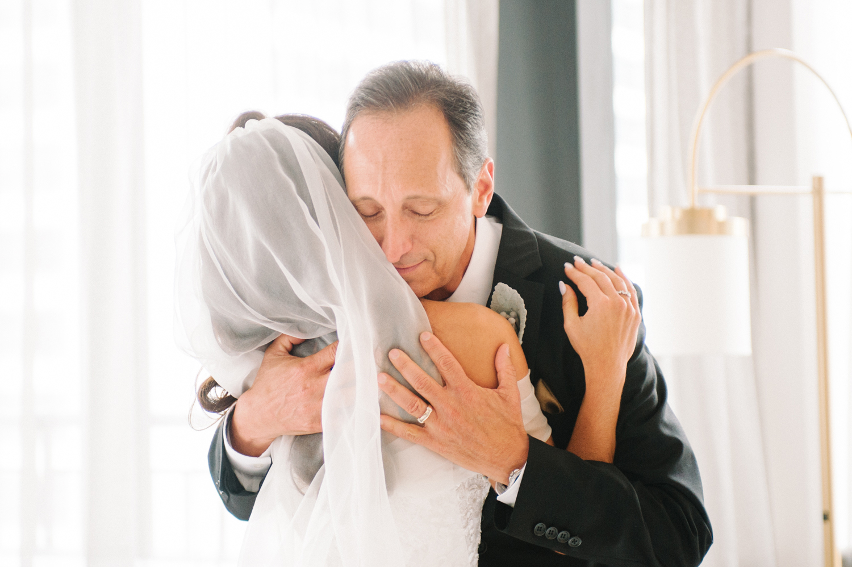 Dad hugging bride, Gwen Hotel Chicago, Midwest fine art wedding photographer Erica Robnett Photography