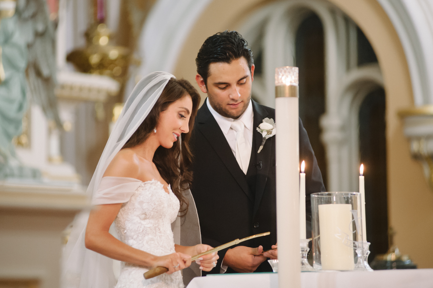 Bride and groom lighting candle at St. Michael in Old Town Chicago, Midwest wedding photographer