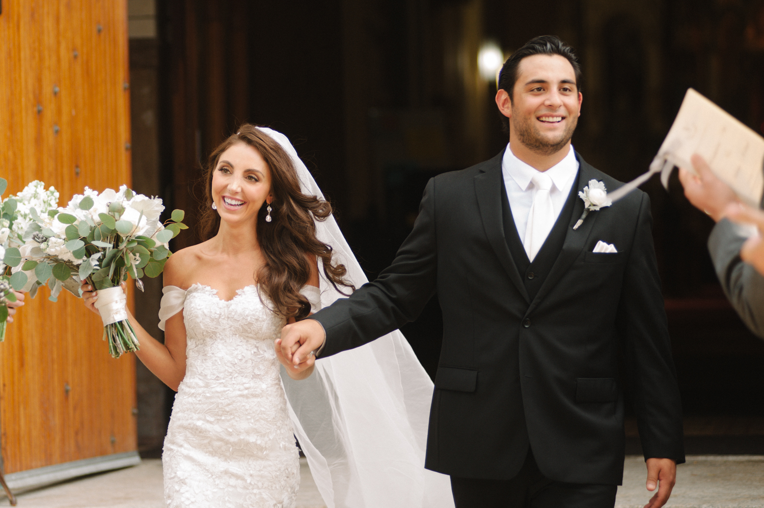 Bride and groom exit the church, Midwest wedding photographer