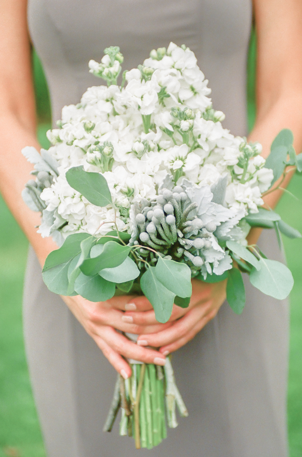 With bridesmaid bouquet with greenery, St. Louis fine art wedding photography