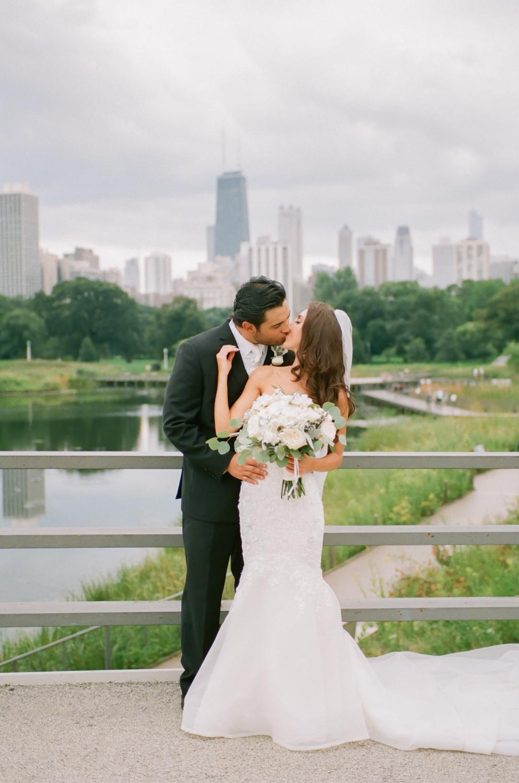 Bride and Groom in Lincoln Park Chicago skyline, Chicago fine art wedding photographer