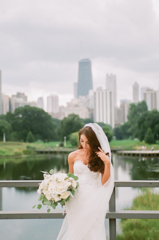 Bride in Lincoln Park Chicago skyline, Chicago fine art wedding photographer