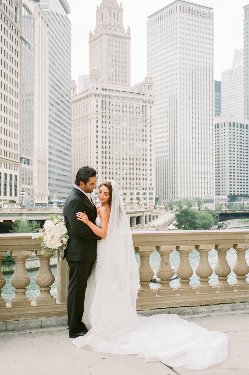 Bride and groom on Michigan Avenue in Chicago, Chicago fine art wedding photography