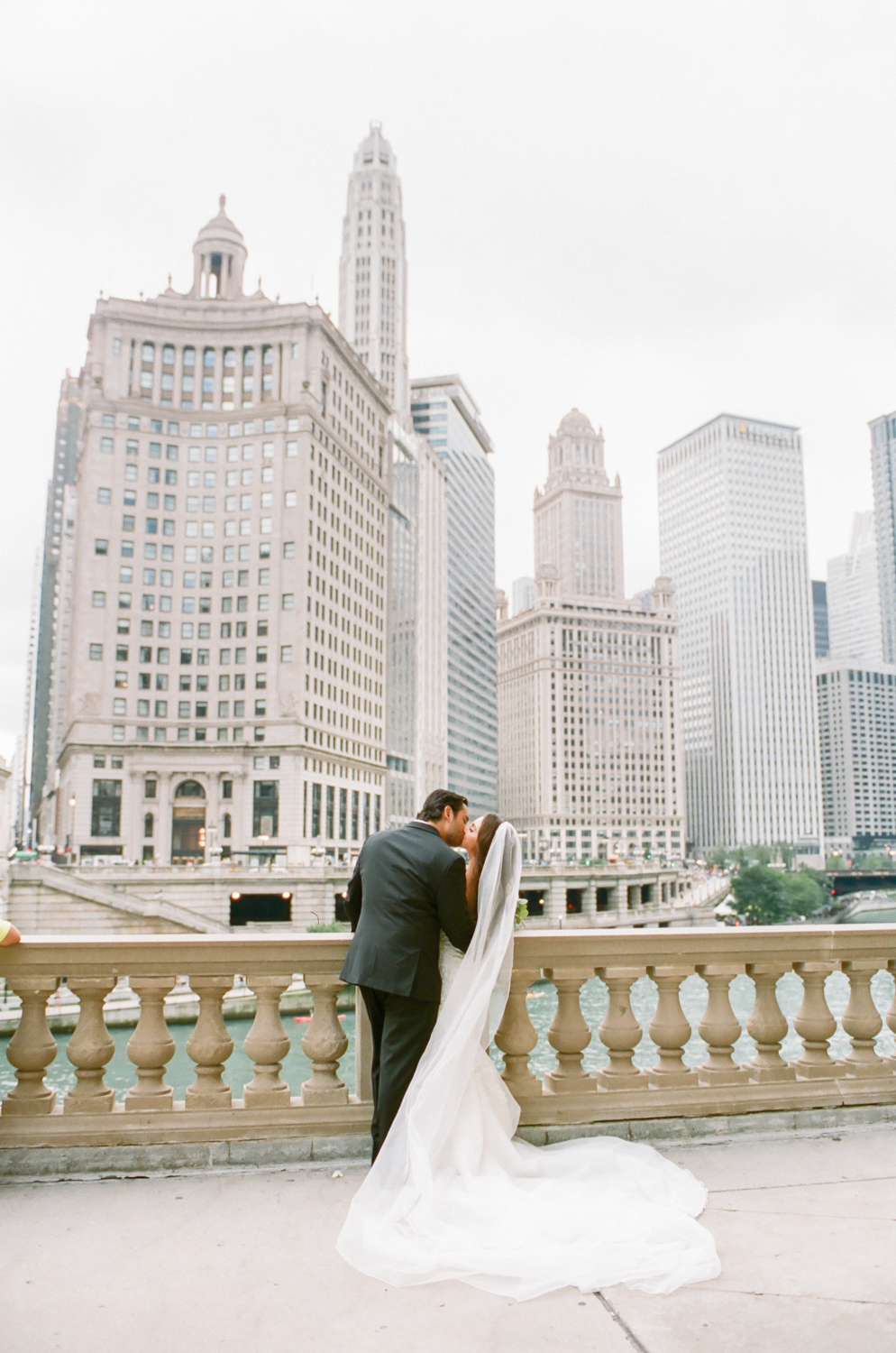 Bride and groom on Michigan Avenue in Chicago, Chicago fine art wedding photography Erica Robnett Photography