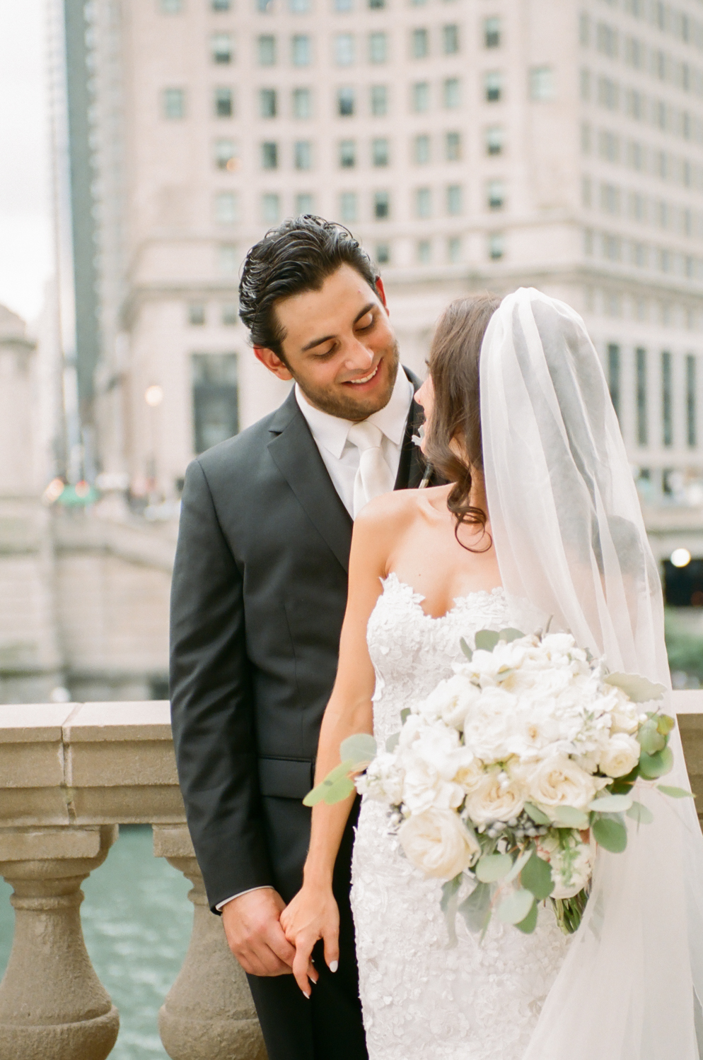 Bride and groom by Chicago canal on Michigan Avenue, Destination fine art wedding photographer