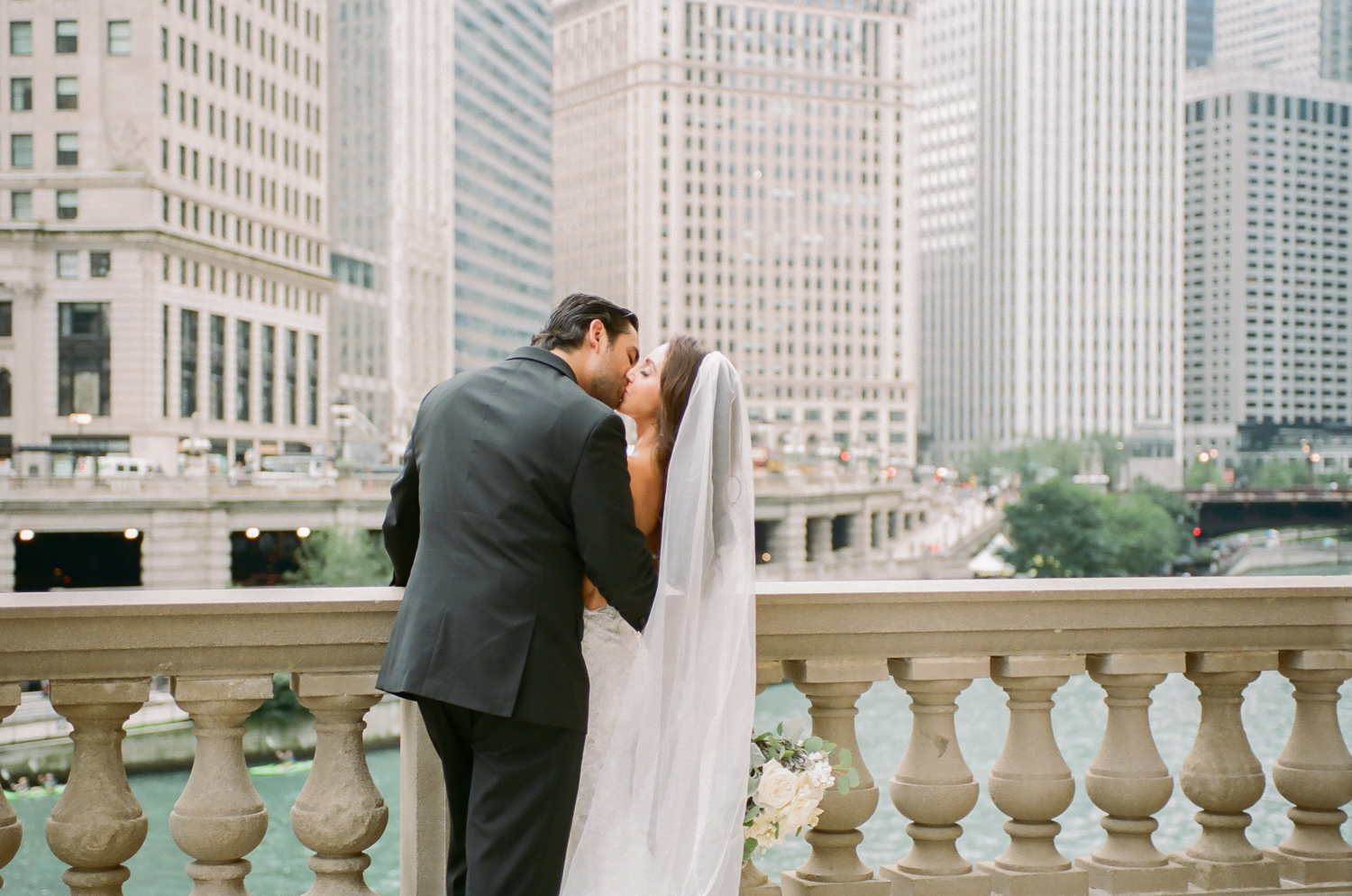 Bride and groom by Chicago canal on Michigan Avenue, Destination fine art wedding photographer Erica Robnett Photography