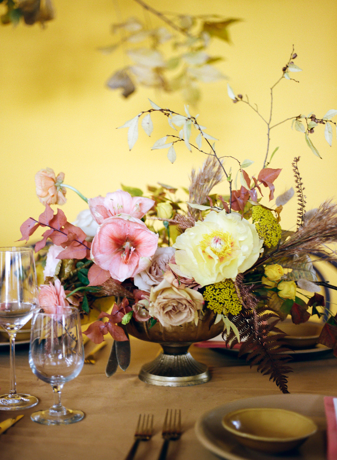 Pink and yellow wedding reception floral table piece; St. Louis Wedding Photographer Erica Robnett Photography