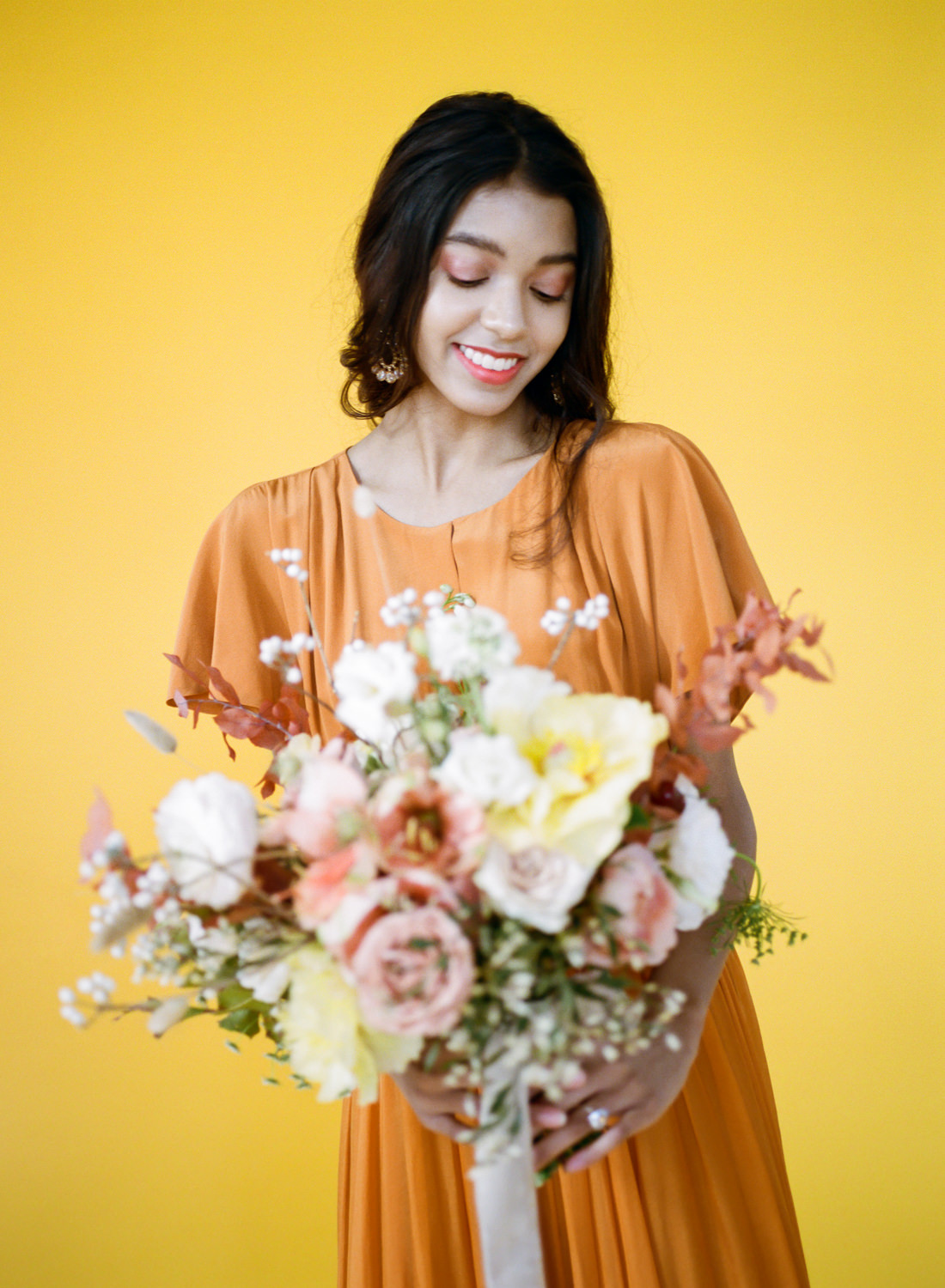 Orange Leanne Marshall gown and peach and pink bridal bouquet; St. Louis Wedding Photographer Erica Robnett Photography