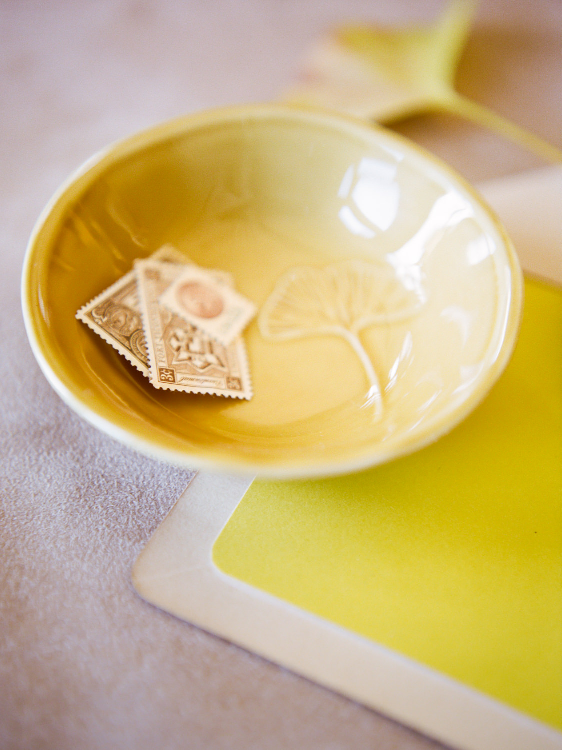Yellow dish and envelope with vintage stamps; St. Louis Fine Art Film Wedding Photographer Erica Robnett Photography