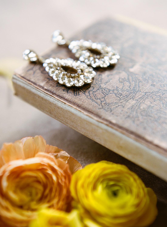 Bridal earrings on book; St. Louis Fine Art Film Wedding Photographer Erica Robnett Photography
